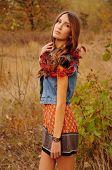 stock photo of auburn  - cute young woman with long auburn hair in the autumn field - JPG