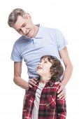 stock photo of grandfather  - Portrait of a healthy grandfather and his grandson are looking at each other over the white background - JPG