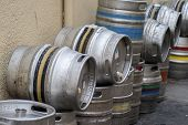 stock photo of keg  - Beer kegs on a side street outside a pub - JPG