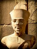stock photo of pharaoh  - Detail of bust of Pharaoh Tutankhamun in one of the precincts of the Temple of Karnak  - JPG