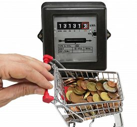 picture of electricity meter  - hand pushes a cart of European money to pay the electricity bills - JPG