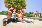 image of tilt  - Sporty girlfriends drinking energetic juice during a break at run training in urban park area  - JPG