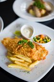 image of tartar  - fish and chips served with tartar sauce and vegetables - JPG