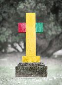 image of guinea  - Old weathered gravestone in the cemetery  - JPG