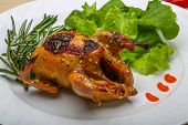 picture of quail  - Roasted Quail with rosemary and spices on the wood background - JPG