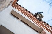 picture of anti-terrorism  - Soldier with a gun on the edge of the roof coming down on a rope - JPG