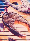 stock photo of salmon steak  - Salmon steak with fresh vegetables and herbs  - JPG