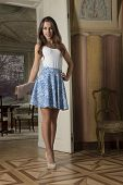 image of palace  - beautiful young woman with summer elegant dress and heels posing in luxury room of aristocratic old palace - JPG