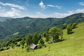 pic of chalet  - Spring mountains with old wooden chalet  - JPG