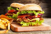 pic of hamburger-steak  - Delicious hamburger and french fries on wooden background - JPG