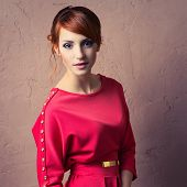 picture of young woman posing the camera  - Beautiful young fashionable woman posing in red dress - JPG