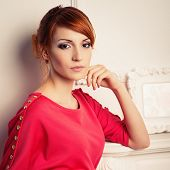 image of young woman posing the camera  - Beautiful young fashionable woman posing in red dress - JPG