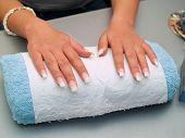 foto of fingernail  - Girl fingernails being manicured in a salon - JPG