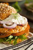 foto of burger  - Homemade Organic Salmon Burger with Tartar Sauce - JPG