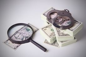 stock photo of punish  - Finance and Law economic crime the punishment of the offender pack of dollars steel handcuffs horizontal image DSLR photography finance and law shadow capital punishment crime - JPG