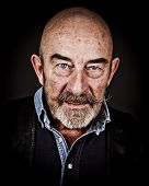 An old man with a grey beard
