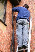 Worker On A Ladder