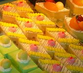Colorful Cakes And Fruity Pastries In Bakery Window