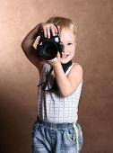 child in studio with professional camera