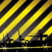 Crane silhouette with yellow and black stripes and barbwire