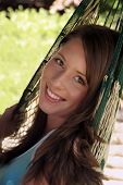 pic of beautiful brunette woman  - Beautiful brunette teenager in a hammock - JPG