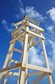 Old wooden lifeguard tower on a beach.
