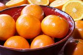 Fruit still life, perfect unblemished oranges.