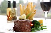 stock photo of oz  - 8 oz tenderloin steak topped with truffle butter - JPG