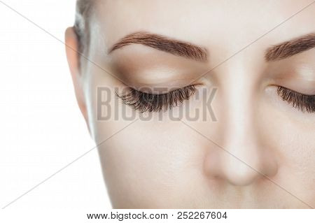 poster of Beautiful Woman With Long Lashes In A Beauty Salon. Eyelash Extension Procedure.