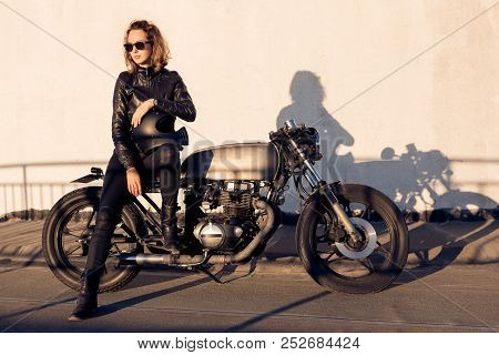 Sexy biker young woman in