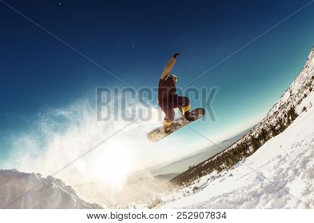 Snowboarder Jumps For Long Distance