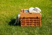 Picnic Basket On Meadow. Outdoor Summer Picnic On The Green Grass At The Sunny Day. Party Time. poster