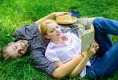 Romantic Couple Students Enjoy Leisure With Poetry Or Literature Grass Background. Couple Soulmates  poster