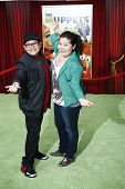 LOS ANGELES - NOV 12: Rico Rodriguez; Raini Rodriguez at the world premiere of 'The Muppets' held at