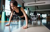 Woman Healthy Training Fit Exercise Plank Physical Planking Workout At Fitness Gym poster