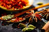 Spices. Various Indian Spices on black stone table. Spice and herbs on slate background. Assortment  poster