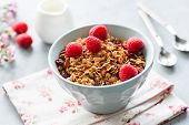 Granola With Fresh Raspberries In A Bowl. Closeup View, Selective Focus. Homemade Tasty Granola. Con poster