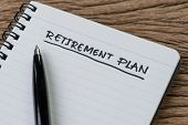 Blank Notepad With Pen And Handwriting Important Headline As Retirement Plan On Wood Table, Planning poster