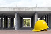 Safety Helmet In Construction Site. Worker Safety And Protect Head Equipment Tools Engineer Concept poster