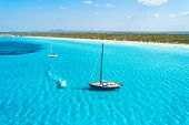 Yacht On The Azure Seashore In Balearic Islands. Aerial View Of Floating Sailboat And Motorboat In T poster