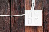 Buzzer Switch On Wooden Wall
