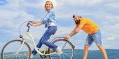Teach Adult To Ride Bike. Find Balance. Woman Rides Bicycle Sky Background. How To Learn To Ride Bik poster