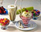 Ice cream with confection and cherries poster