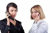 Two Business Women Talking On Mobile Phone