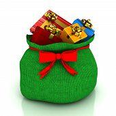 Christmas bag with gifts over white