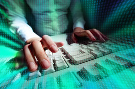 stock photo of backspace  - Picture of a person typing at a keyboard with matrix effect put over - JPG