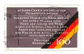 Circa 1990: A Stamp Printed In The Germany Shows 40Th Anniversary Of Charter Of German Expellees, Ri