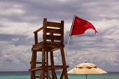 Empty Lifeguard Chair And Umbrella At Beach