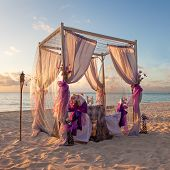 Romantic Wedding Table On Sandy Tropical Caribbean Beach At Sunset
