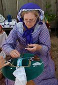 Woman In Costume Makes Bobbin Lace